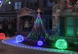 make a diy light tree for the yard using string lights and a basketball pole