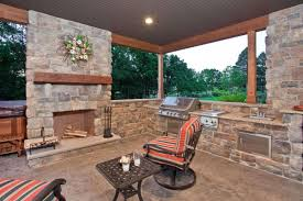 decorations rustic patio with outdoor fireplace decor and stone structure kitchen cabinet and stainless steel stove plus cozy chair added black iron small