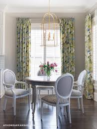 fabulous dining room features a gold leaf lantern illuminating a round french dining table