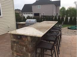 home outdoor bar grill with marble countertops