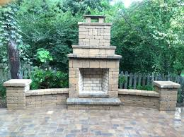 Outdoor fireplace with wing walls, columns and brick paver patio. Creative  Stone Landscaping Franklin
