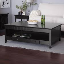 good looking coffee table with storage and white sofabed with wood laminate floor