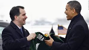 President Obama receives a Green Bay Packers NFL football team jersey with  '. Photos: Scott Walker's career