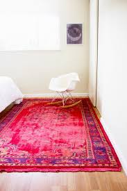 A vividly-colored overdyed rug can become the perfect focal point for a  simple room