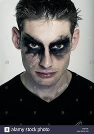 male goth man in goth makeup punk subculture