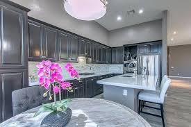 white quartz countertops pros and cons dark gray kitchen cabinets and gray painted walls