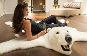 add some classic white to your home with fluffy polar bear rug