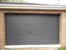 image result for sectional garage door with wicket door