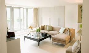decoration apartment. Modern Apartment Decoration With Beige Sectional Sofa And Glossy Black Coffee Table