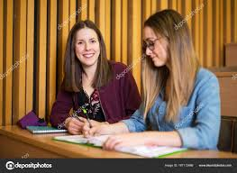 Studying Young Teenage College Student Girl In A School Stock