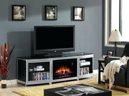 the media console features a electric fireplace insert surrounded by bow front glass tv stand crushed stands