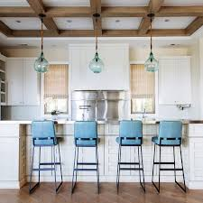 turquoise blue leather kitchen island stools with blue glass pendants