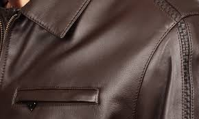 a leather or suede coat is not a raincoat if the jacket gets wet accidentally dry it at room temperature never above or near a radiator or in the sun