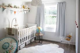 bright looking small baby nursery room decor grey blueish color lots of tiny dolls globe oriental umbrella baby nursery ideas small