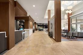 the lobby or reception area at hilton garden inn new orleans convention center