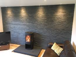high efficiency wood burning fireplace. Contura 850 High Efficiency Wood Burning Stove With A Feature Wall Formed In Natural Slate Cladding, Complete Downlights And An Antique Nero Granite Fireplace ,
