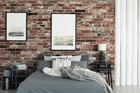 hanging pictures on brick