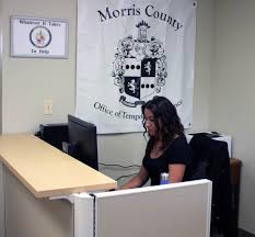 photo of female worker at desk in new dover ota office