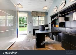 blue modern home office interior design with dark brown furniture preview save to a lightbox blue brown home office