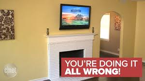 3 reasons you should never mount a tv above a within hanging tv above fireplace