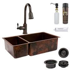 premier copper s all in one undermount hammered copper 33 in 0 hole 25 75 double bowl kitchen sink in oil rubbed bronze ksp2 k25db33199 the home