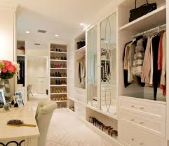 white walk in closet with dressing table