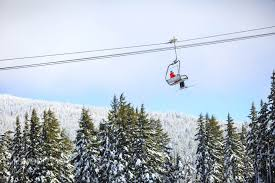 chair lift. Brilliant Chair Single Skier Sitting On A Chairlift Going Up The Mountain Stock Photo U2014  PixelTote And Chair Lift H