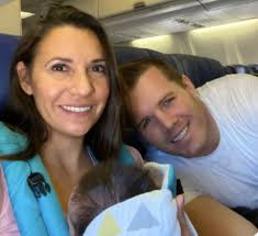 Parents Flying Home with Adopted Baby Get Surprised | CafeMom.com