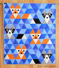Sew Fresh Quilts: Equilateral Triangle Quilt Tutorial & I now have two patterns for sale which use equilateral triangles. The first  is the Fox & Friends triangle quilt for sale here. Adamdwight.com