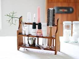 vine wood rack holds and organizes grooming accessories