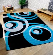 teal and cream rug designs