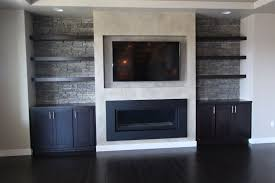 room contemporary style western maple recessed panel dark black color entertainment center floating shelves tv above the fireplace wood tops built ins