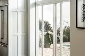 sliding patio door in kitchen leading to backyard patio simonton