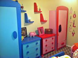 ikea toy storage in red and blue with picture frame above and wheat wall
