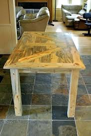 kill pine top on this table sits heavy square post legs finished with several coats of