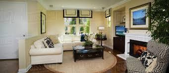 living room with sectional sofa and circular area rug panoramic