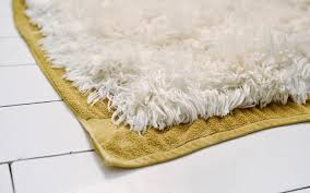 using a metal bristled sheepskin brush fluff the wool gently while still damp brush it once again while drying and do a final brush after it s dried