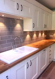 design of tiles in kitchen. our edge grigio tiles look lovely in a cream kitchen with wooden worktops design of pinterest