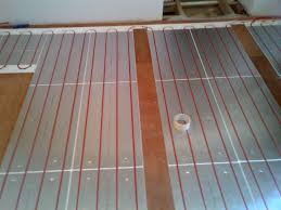 can you put laminate flooring over underfloor heating