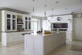 kitchens with white cabinets and tile floors photo 1