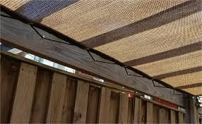 tan black 80 knit shade panel laced to wood structure with 3 8 rope