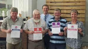 Volunteers Les, Jane and Dale Goldie and Ray Fallon recognised in ...