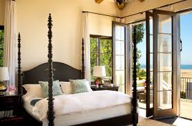 ... modern spanish colonial bedroom with four posters bed and folding patio  door also large balcony ...