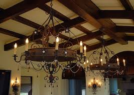 rustic dining room with large wrought iron chandelier over round rustic large chandeliers