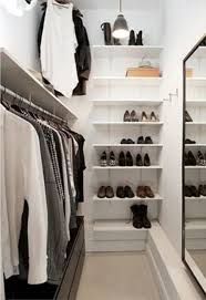 perfect minimalist closet layout with a leading rack on one wall, a mirror  on the