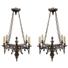 pair of continental gothic style four light chandeliers for