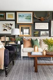 art gallery over ivory wingback sofa