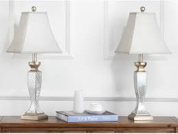 description hand applied mirror mosaic tiles highlight this set of table lamps