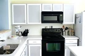 how to paint over laminate cabinets how to paint laminate doors to refinish laminate cabinets stripping