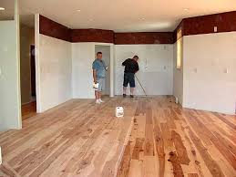 rustic hickory flooring with finish being applied